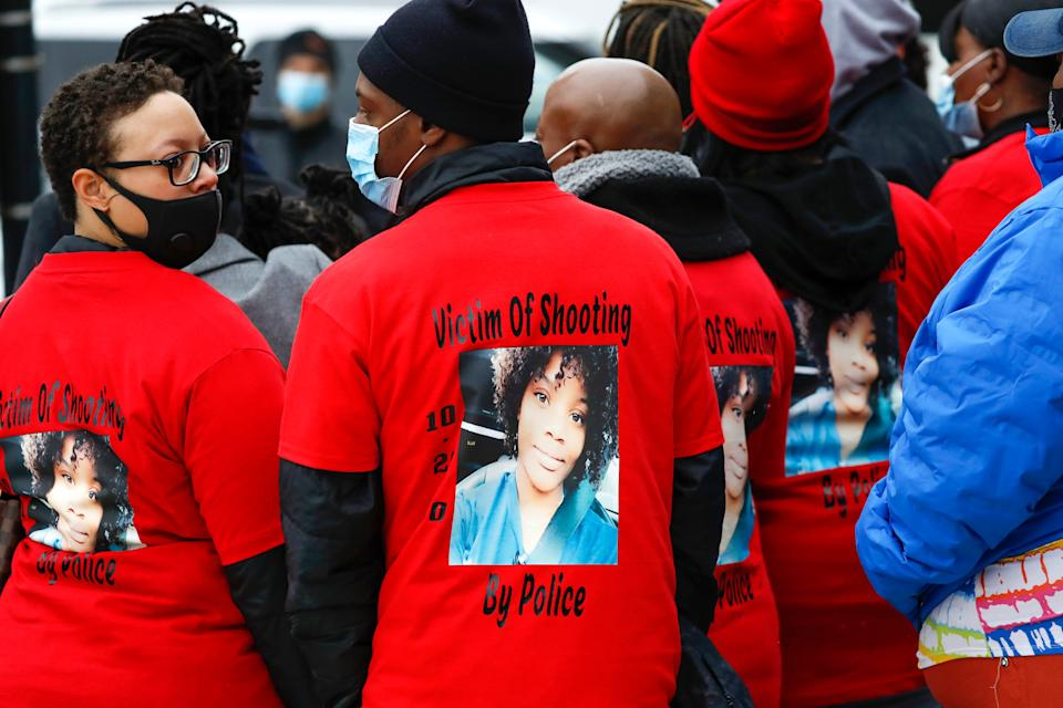 The family of Tafara Williams, pictured on the back of several t-shirts, who was wounded by a Waukegan police officer, gather outside of Waukegan City Hall in Waukegan, Ill., on Tuesday, Oct. 27, 2020.