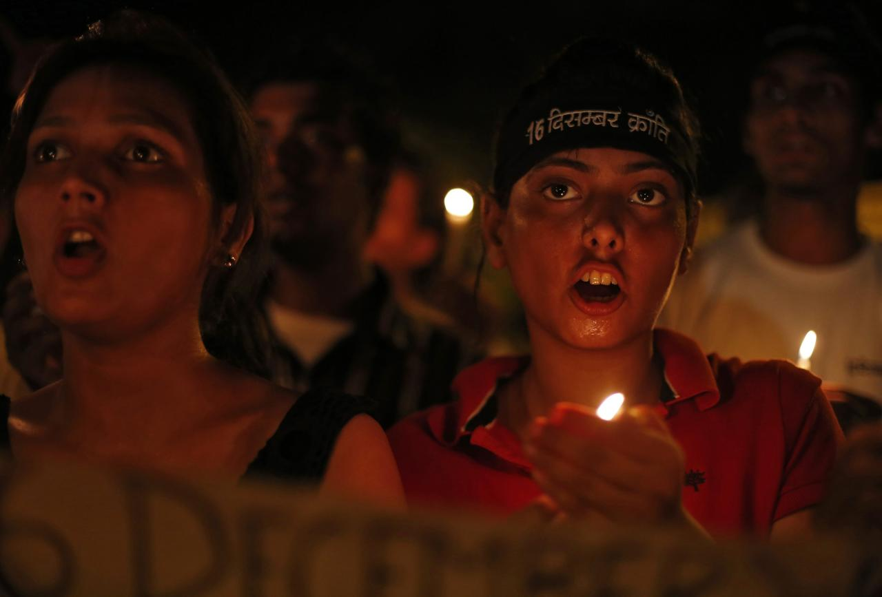 Demonstrators shout slogans as they hold candles during a candle light vigil after four men convicted of raping and murdering a 23-year-old woman in Delhi were sentenced to death in New Delhi September 13, 2013. Four men were sentenced to death on Friday for raping and murdering a woman in New Delhi last December, satisfying a public clamour for them to be hanged for a crime that forced India to confront its culture of violence against women. The demonstrators were demanding capital punishment for rapists during the vigil, demonstrators said. REUTERS/Mansi Thapliyal (INDIA - Tags: CRIME LAW)