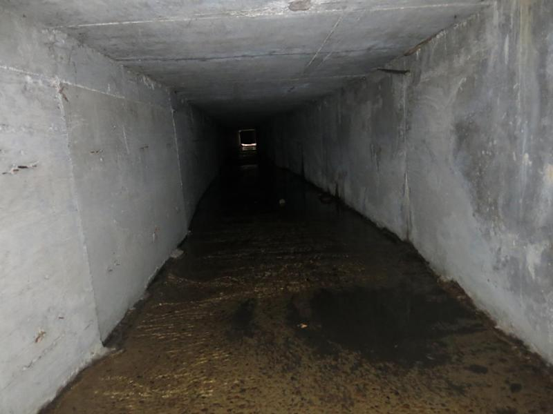 """An interconnected tunnel in the city's drainage system that infamous drug boss Joaquin Guzman Loera, """"El Chapo"""" used to evade authorities, is shown, in Culiacan, Mexico, Sunday Feb. 23, 2014. A day after troops narrowly missed infamous Guzman in Culiacan, one of his top aides was arrested. Officials said he told investigators that he picked up Guzman from a drainage pipe and helped him flee to Mazatlan but a wiretap being monitored by ICE agents in southern Arizona provided the final clue that led to the arrest of one of the world's most wanted men. (AP Photo/Adriana Gomez)"""