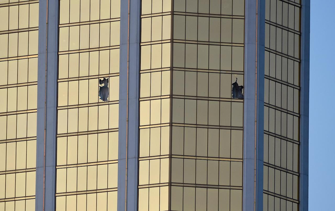 <p>Broken windows are seen on the 32nd floor of the Mandalay Bay Resort and Casino after a lone gunman opened fired on the Route 91 Harvest country music festival on Oct. 2, 2017 in Las Vegas. (Photo: David Becker/Getty Images) </p>
