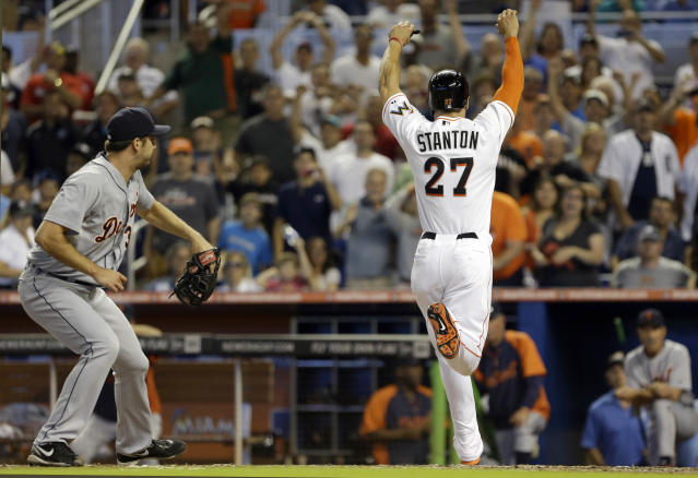 Miami Marlins' Giancarlo Stanton (27) scores the winning run against the Detroit Tigers in the ninth inning of an interleague baseball game on Sunday, Sept. 29, 2013, in Miami. Stanton scored on a wild pitch by Luke Putkonen, left, as the Marlins won 1-0. (AP Photo/Alan Diaz)