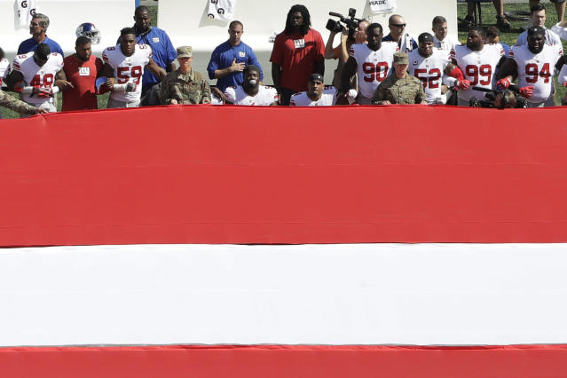 <p>Some New York Giants players take a knee for the national anthem before an NFL football game against the Philadelphia Eagles, Sept. 24, 2017, in Philadelphia. (Photo: Michael Perez/AP) </p>
