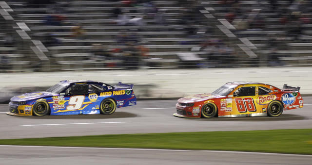 Chase Elliott (9) leads Dale Earnhardt Jr. (88) during the NASCAR Nationwide Series auto race at Texas Motor Speedway in Fort Worth, Texas, Friday, April 4, 2014. Elliott won, and Earnhardt finished in fifth place. (AP Photo/Mike Stone)