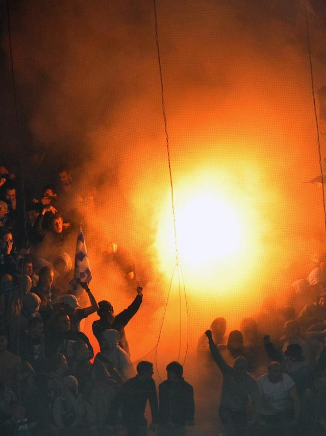 Fans of FC Zenit wave flares and flags during the UEFA Champions League Group G football match against FC Shakhtar in Donetsk on October 19, 2011. AFP PHOTO/ SERGEI SUPINSKY (Photo credit should read SERGEI SUPINSKY/AFP/Getty Images)