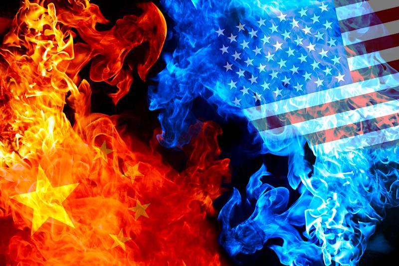 Representations of flags from US and China in fire and smoke.