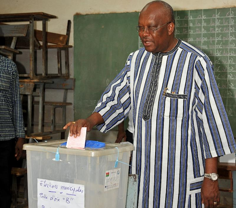 Burkina Faso's President Roch Marc Christian Kabore casts his vote in municipal elections in Ouagadougou