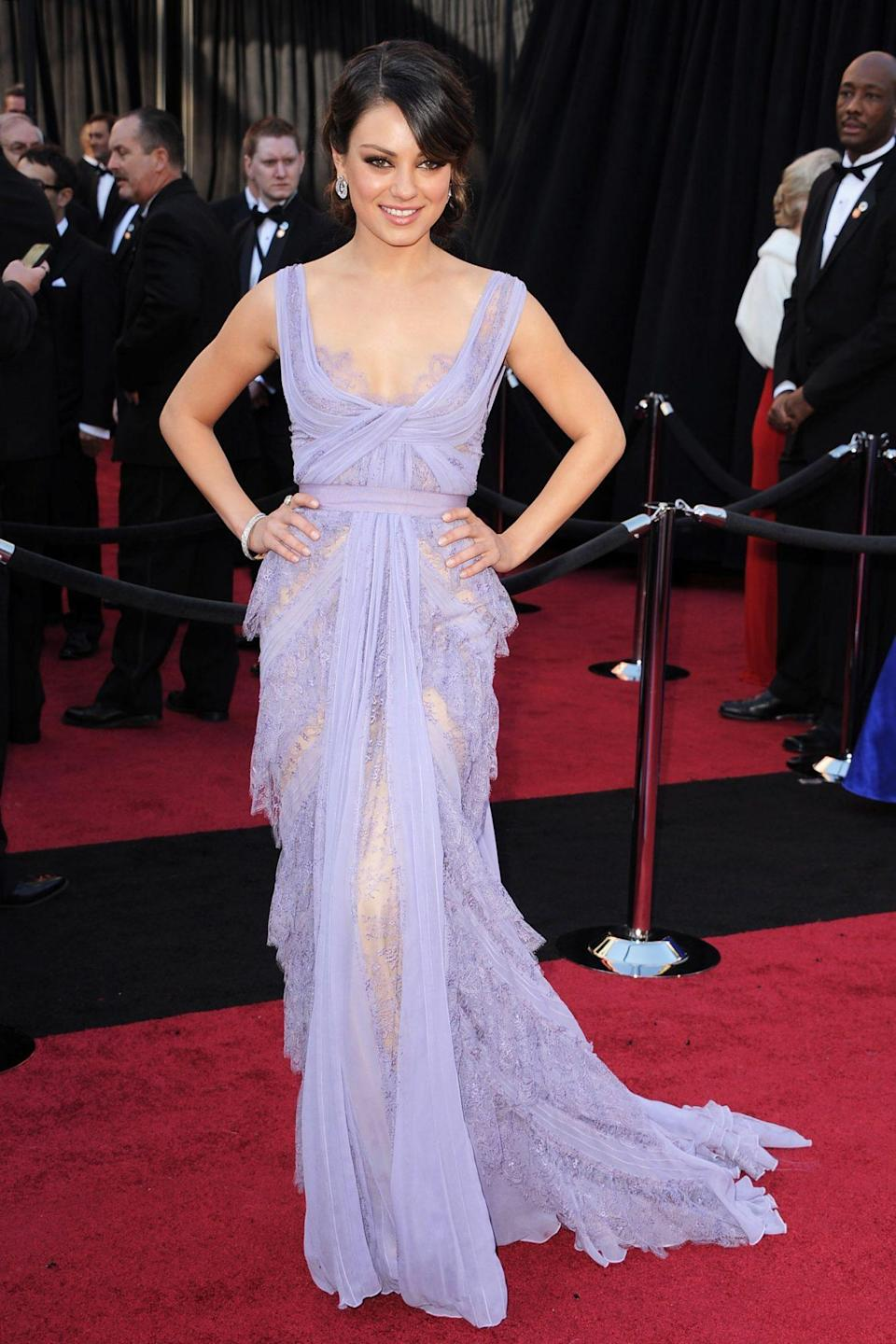<p>Mila Kunis was a vision in lacy lavender Elie Saab. Her first Oscars, Kunis was there with the cast of <em>Black Swan</em>, which was nominated for Best Picture. </p>