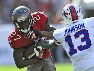 Johnthan Banks (27) is stopped by then-Bills WR Steve Johnson (13) after intercepting a pass last season. (AP)