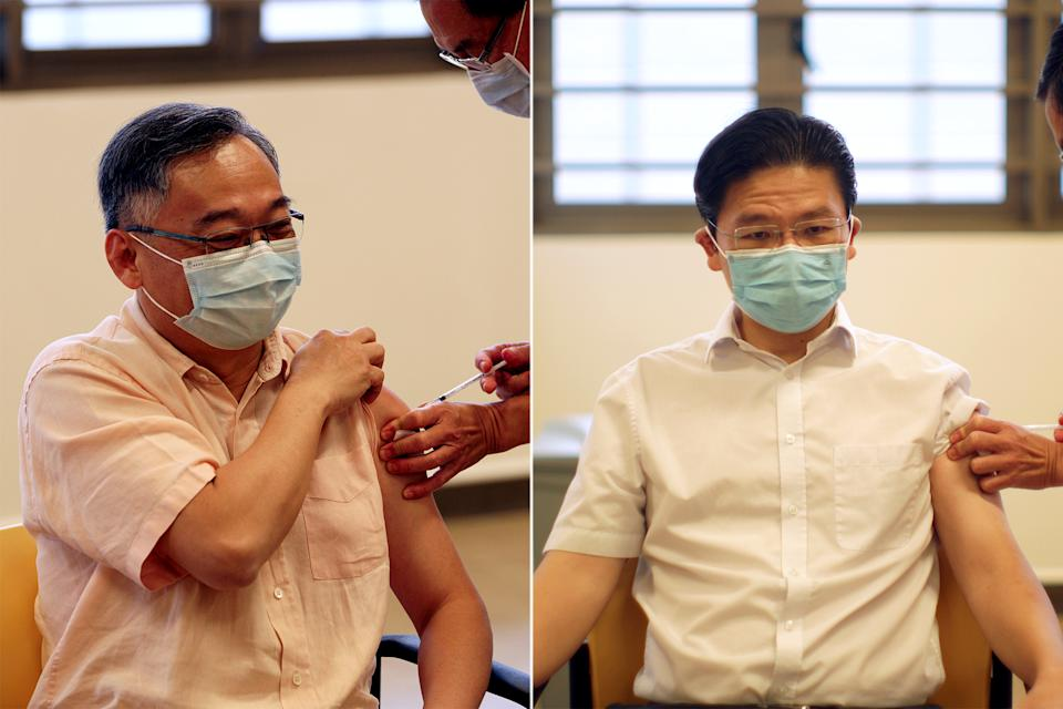 The co-chairs of the multi-ministry taskforce for COVID-19, Gan Kim Yong (left) and Lawrence Wong, receive their first doses of coronavirus vaccinations at Kwong Wai Shiu Hospital on 13 January. (PHOTOS: Ministry of Communication and Information)