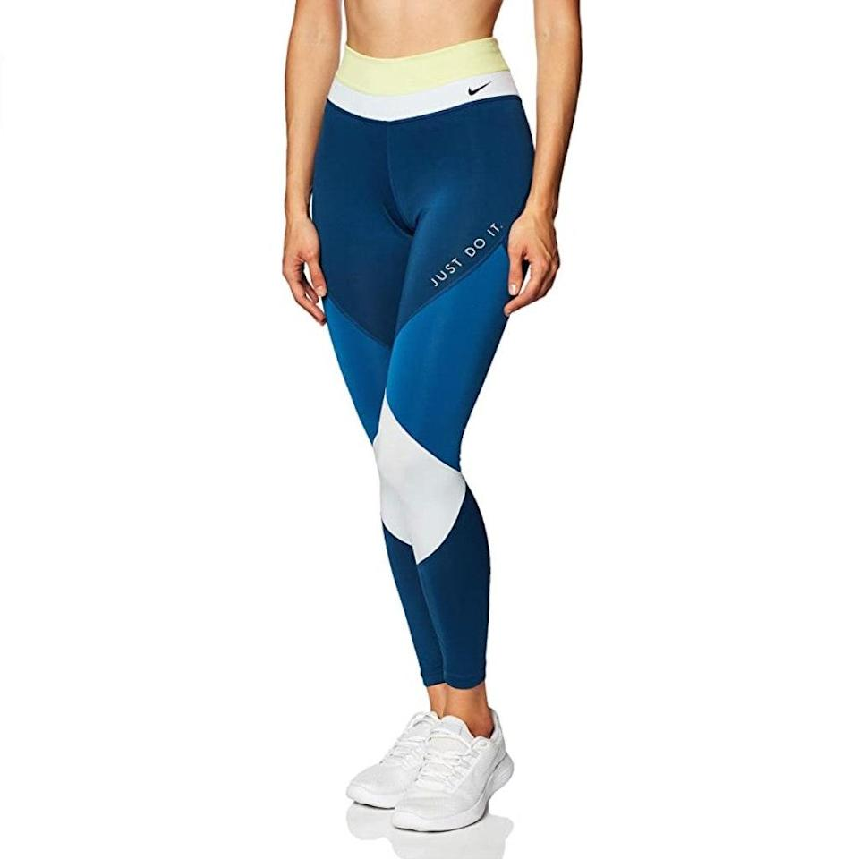 """A touch of color block, for vitality. $73, Amazon. <a href=""""https://www.amazon.com/Nike-Womens-Color-Tights-CJ2450-367/dp/B084WKWVHP/"""" rel=""""nofollow noopener"""" target=""""_blank"""" data-ylk=""""slk:Get it now!"""" class=""""link rapid-noclick-resp"""">Get it now!</a>"""
