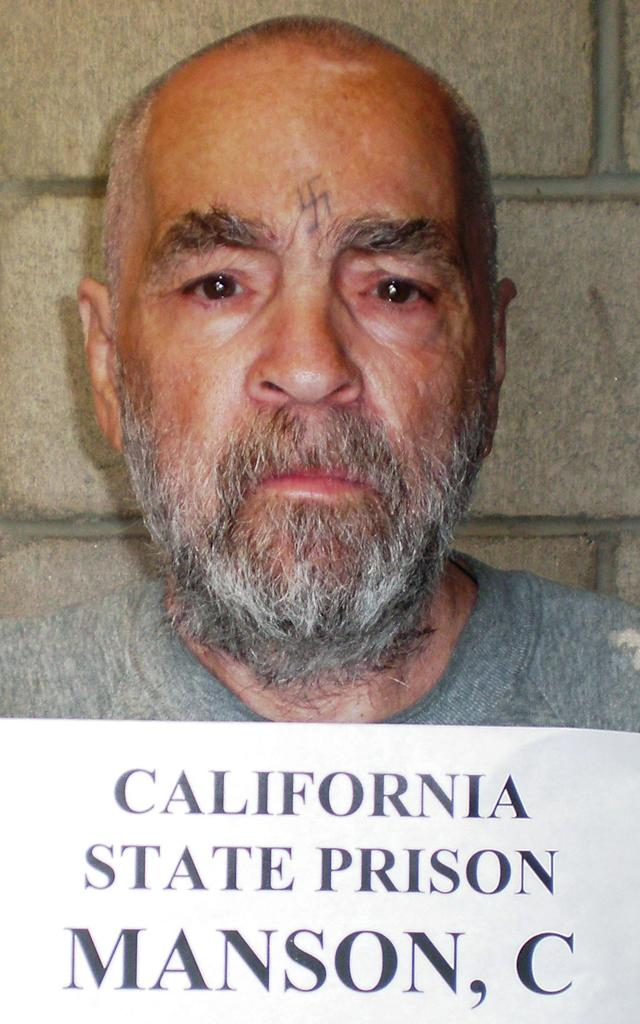 <p>Convicted murderer Charles Manson, 74, is shown in this handout image released March 18, 2009 from Corcoran State Prison in California. Manson was serving a life sentence for his conspiracy role in the killing of seven people in the Tate-LaBianca murders in Los Angeles, 1969. (Photo: Corcoran State Prison/Reuters) </p>