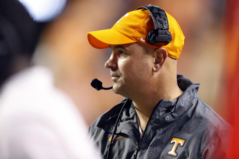 Tennessee head coach Jeremy Pruitt watches action in the first half of an NCAA college football game against Vanderbilt Saturday, Nov. 30, 2019, in Knoxville, Tenn. (AP Photo/Wade Payne)
