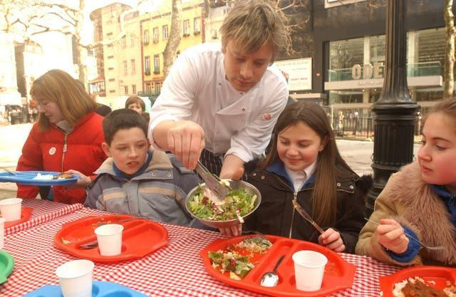 Jamie Oliver serves dinners to children – Leicester Square