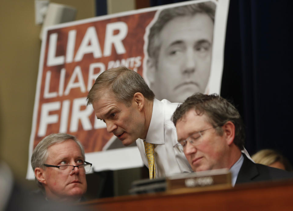 Rep. Jim Jordan, R-Ohio, center, ranking member of the Committee on Oversight and Reform talks with Rep. Mark Meadows, R-N.C., left, and Rep. Thomas Massie, R-Ky., right, during testimony by Michael Cohen, President Donald Trump's former personal lawyer on Capitol Hill in Washington, Wednesday, Feb. 27, 2019. (AP Photo/Pablo Martinez Monsivais)
