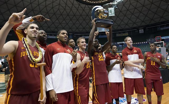 The Iowa State basketball team shows off the Diamond Head Classic championship trophy to their fans after defeating Boise State 70-66 in an NCAA college basketball game Wednesday, Dec. 25, 2013, in Honolulu. (AP Photo/Eugene Tanner)
