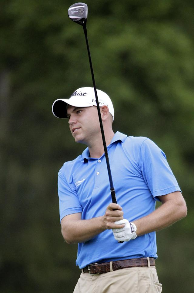 Bill Haas watches his shot on the eight hole during the first round of the Houston Open golf tournament on Thursday, April 3, 2014, in Humble Texas. (AP Photo/Patric Schneider)