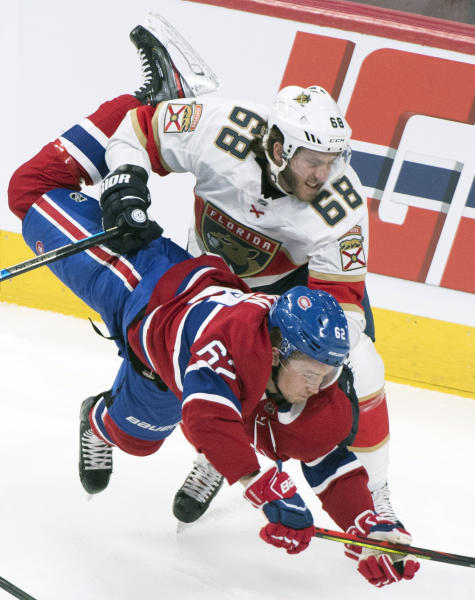 Florida Panthers' Mike Hoffman (68) upends Montreal Canadiens' Artturi Lehkonen during the second period of an NHL hockey game, Saturday, Feb. 1, 2020 in Montreal. (Graham Hughes/The Canadian Press via AP)