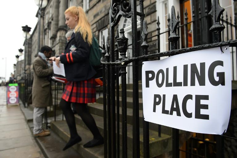A young voter leaves a polling station after casting her referendum vote in Edinburgh on September 18, 2014 (AFP Photo/Leon Neal)