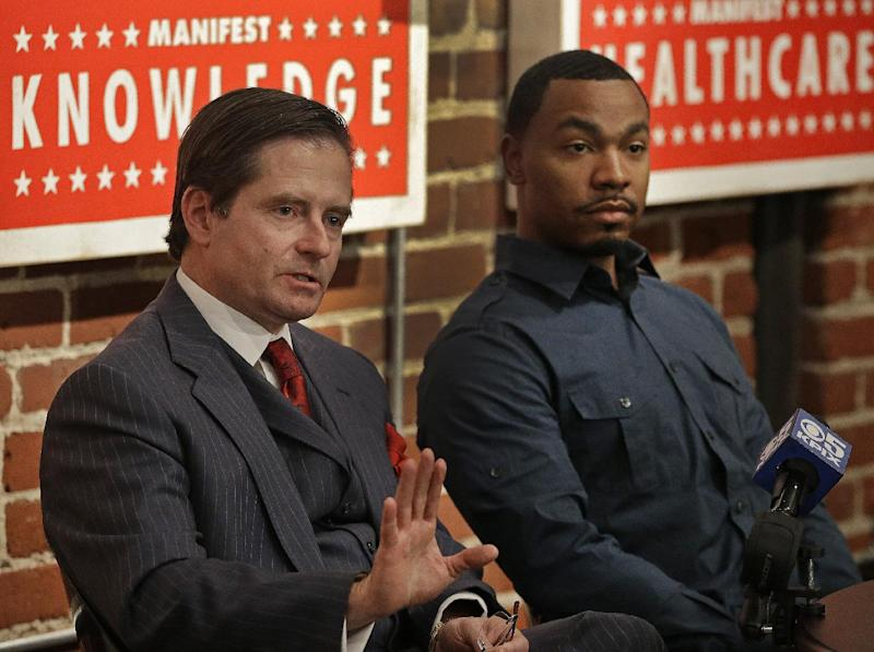 Attorney Christopher Dolan, left, representing the family of Jahi McMath, gestures beside Omari Sealey, Jahi's uncle, during a media conference Monday, Jan. 6, 2014, in San Francisco. Dolan said Monday that a critical care team has delivered Jahi McMath to a new facility, but wouldn't say where it was located. McMath, who had surgery for sleep apnea at Children's Hospital Oakland and then had complications, was declared brain dead on Dec. 12, 2013. McMath left the hospital in a private ambulance shortly before 8 p.m. Sunday. She was moved by a critical care team while attached to a ventilator but without a feeding tube. (AP Photo/Ben Margot)