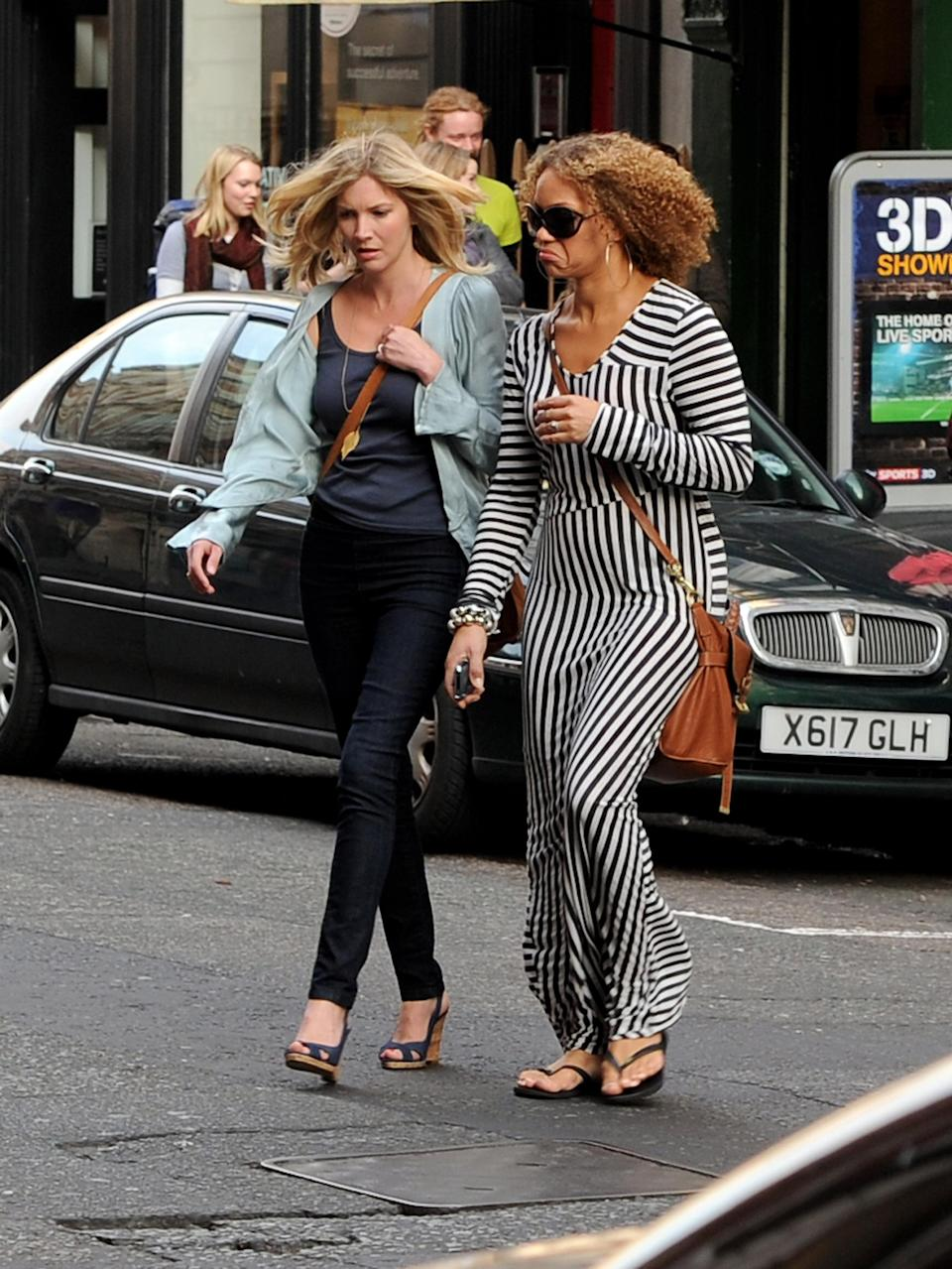 Actress Angela Griffin (right) – pictured here with best friend Lisa Faulkner – says she's still insecure about her foot size.