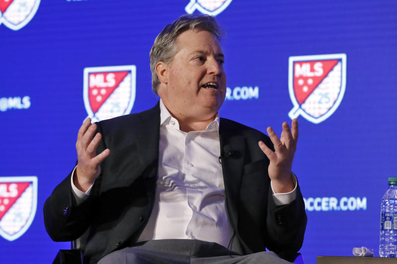 Los Angeles FC lead owner Larry Berg gestures during an interviewed at the Major League Soccer 25th Season kickoff event in New York, Wednesday, Feb. 26, 2020. (AP Photo/Richard Drew)
