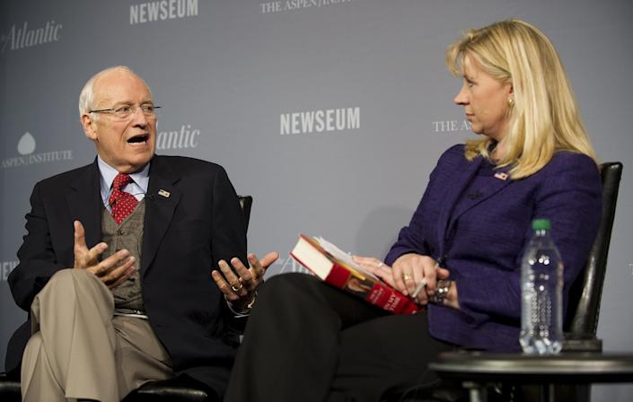 Former U.S. Vice President Dick Cheney (L) speaks with his daughter Liz during the 2011 Washington Ideas Forum at the Newseum in Washington, DC, October 6, 2011. (JIM WATSON/AFP/Getty Images)