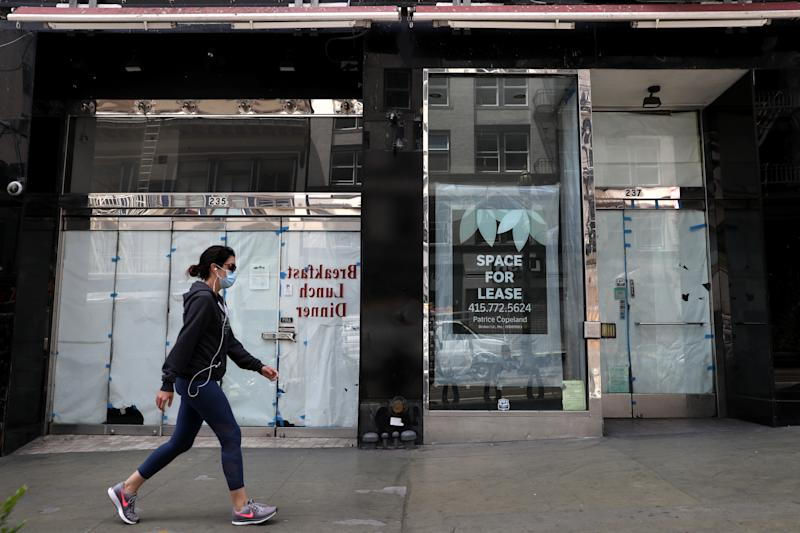 SAN FRANCISCO, CALIFORNIA - MAY 15: A pedestrian walks by closed stores on May 15, 2020 in San Francisco, California. Malls and other businesses shutdown in an attempt to contain the coronavirus causing the U.S. retail sales to fall by a record 16.4% from March to April. (Photo by Justin Sullivan/Getty Images)
