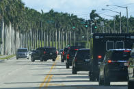 President Donald Trump's motorcade drives to the Trump International Golf Club, Friday, Dec. 25, 2020, in West Palm Beach, Fla. (AP Photo/Patrick Semansky)