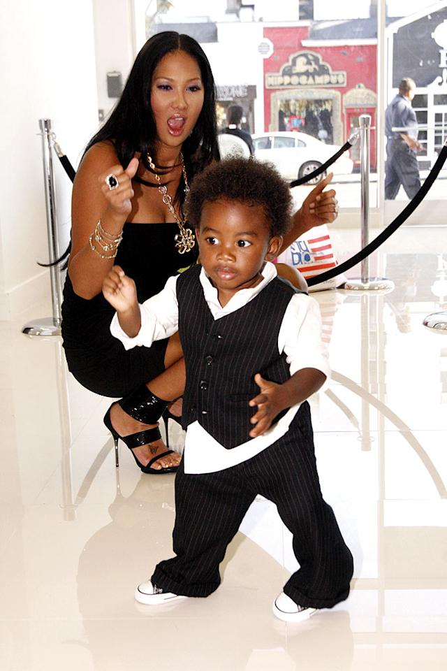 """Kimora Lee Simmons tried out her dance moves with her gorgeous baby boy, Kenzo Lee Hounsou, at his big sister Aoki Lee's fashion show-themed 8th birthday party on Tuesday in West Hollywood. The best part? The bash was staged for the Make-A-Wish Foundation, which grants the requests of children with life-threatening medical conditions. Matthew Simmons/<a href=""""http://www.wireimage.com"""" target=""""new"""">WireImage.com</a> - August 24, 2010"""