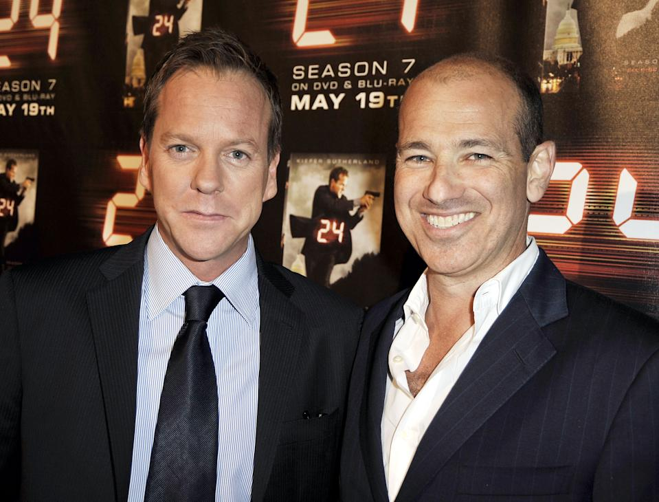 """LOS ANGELES, CA - MAY 12:  Actor Kiefer Sutherland (L) and exec. prod. Howard Gordon pose at the screening of the season finale for Fox's """"24"""" at the Wadsworth Theater on May 12, 2009 in Los Angeles.  (Photo by Kevin Winter/Getty Images)"""