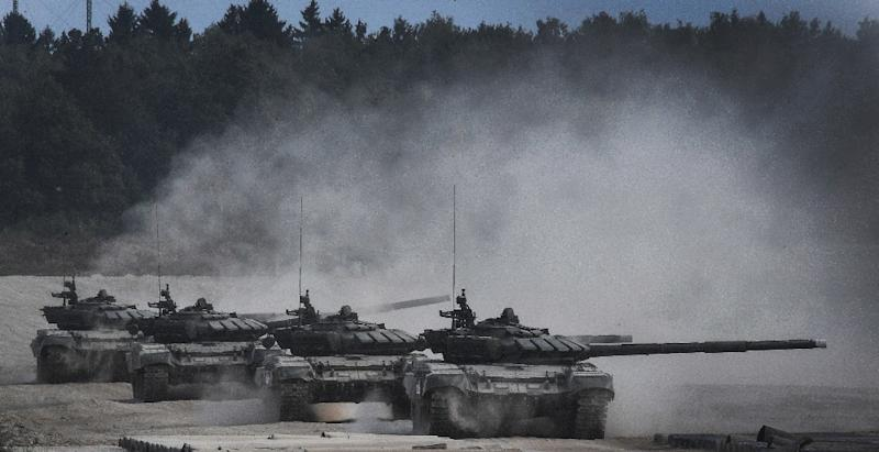 Moscow says the drills involve 12,700 troops, 70 aircraft, 250 tanks and 10 battleships testing their firepower against an imaginary foe close to borders with Poland and the Baltic States (AFP Photo/Alexander NEMENOV)
