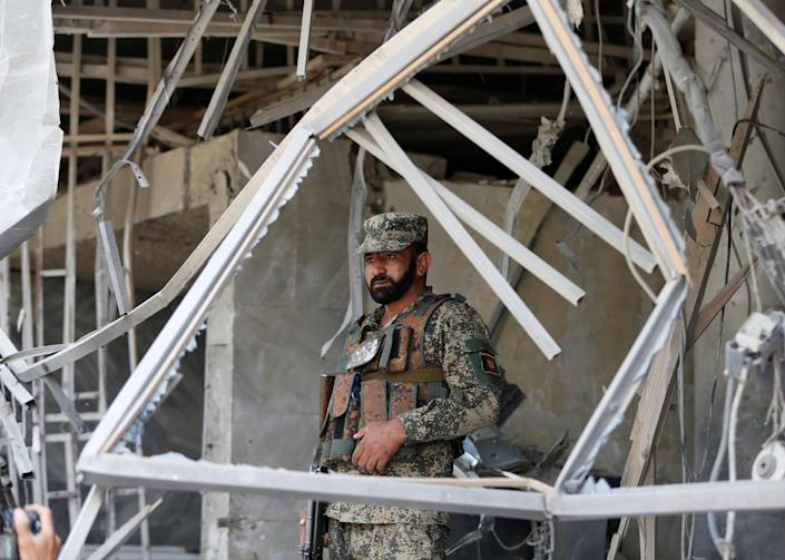 <p>An Afghan security force stands guard at the site of a suicide bomb attack in Kabul, Afghanistan, Aug. 29, 2017. (Photo: Omar Sobhani/Reuters) </p>