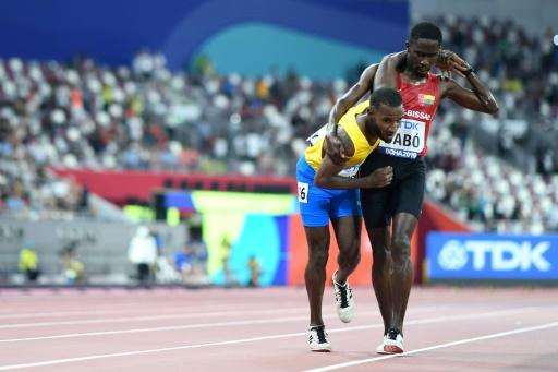 Helping hand of humanity -- Guinea-Bissau's Braima Suncar Dabo became an unlikely star when he stopped and helped toiling Aruban runner Jonathan Busby over 250 metres out to cross the line in the 5,000 metres