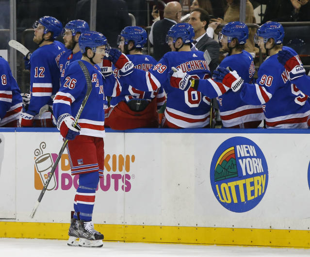 New York Rangers left wing Jimmy Vesey (26) celebrates after scoring a goal against Buffalo Sabres during first period of an NHL hockey game, Saturday, March 24, 2018, in New York. (AP Photo/Noah K. Murray)