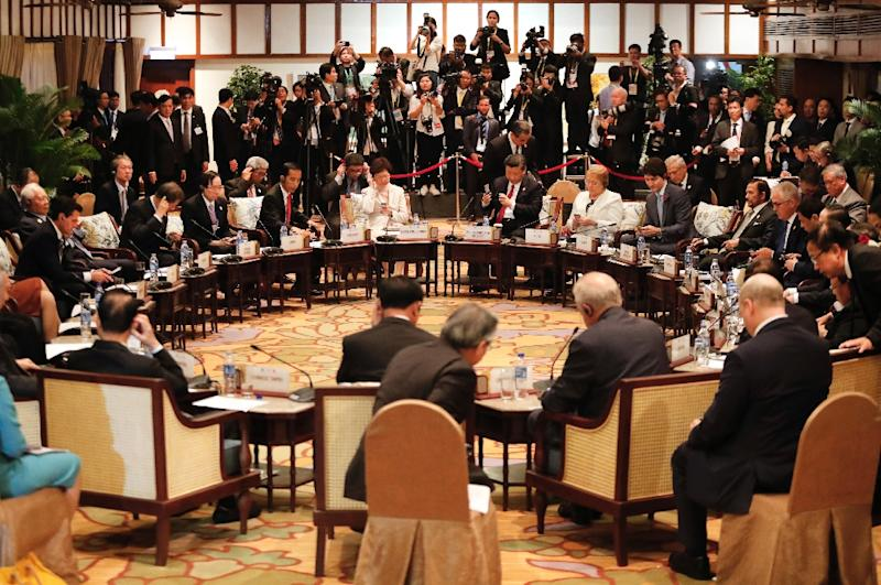 After days of talks on the sidelines of the APEC summit in Danang, the so-called TPP-11 nations made a breakthrough early Saturday, a day after Donald Trump's ladled out more 'America First' rhetoric in an address to world leaders (AFP Photo/JORGE SILVA)