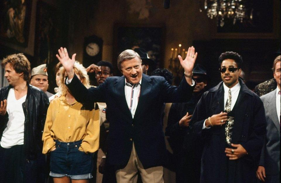 """SATURDAY NIGHT LIVE -- Episode 3 -- Pictured: (l-r) George Steinbrenner, Morris Day during """"Goodnights"""" on October 20, 1990 -- (Photo by: Alan Singer/NBCU Photo Bank/NBCUniversal via Getty Images via Getty Images)"""