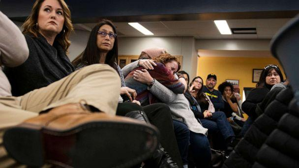 PHOTO: Lisa Householder is embraced after giving an emotional speech during a school diversity and inclusion meeting community meeting at Liberty School in Saline, Mich., Monday, Feb. 3, 2020. (Nicole Hester/Ann Arbor News via AP)