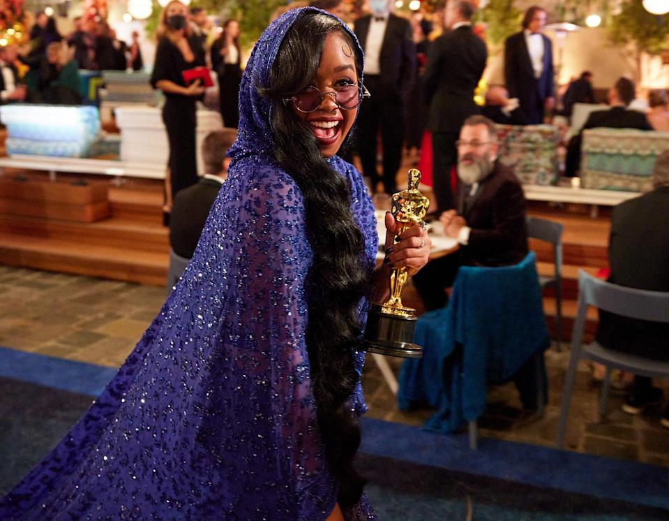 """<p>Singer H.E.R. celebrates her win for Best Original Song (and the fact that <a href=""""https://people.com/movies/oscars-2021-her-halfway-to-egot-after-best-original-song-win/"""" rel=""""nofollow noopener"""" target=""""_blank"""" data-ylk=""""slk:she's halfway to an EGOT"""" class=""""link rapid-noclick-resp"""">she's halfway to an EGOT</a> at 23!) outside the ceremony. </p>"""
