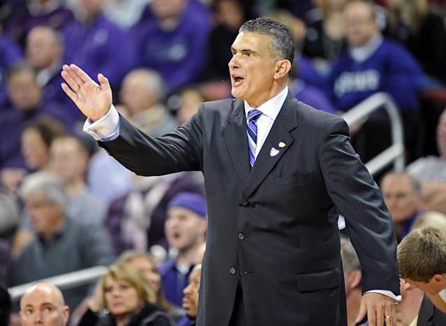 Head coach Frank Martin of the Kansas State Wildcats reacts to a call against the West Virginia Mountaineers during the first half on December 8, 2011 at INTRUST Bank Arena in Wichita, Kansas. (Photo by Peter G. Aiken/Getty Images)