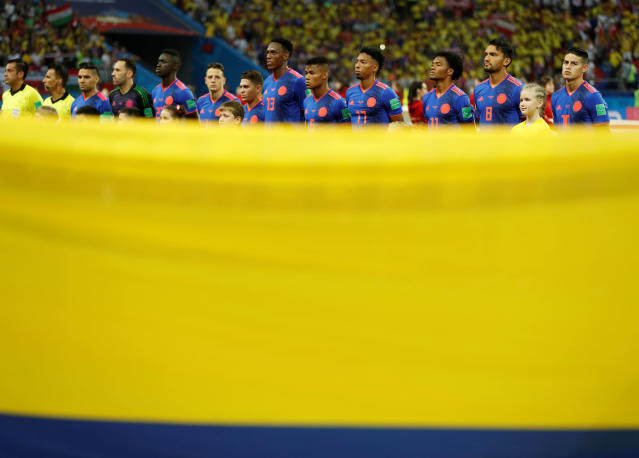 Soccer Football - World Cup - Group H - Poland vs Colombia - Kazan Arena, Kazan, Russia - June 24, 2018 Colombia players line up during the national anthems before the match REUTERS/John Sibley