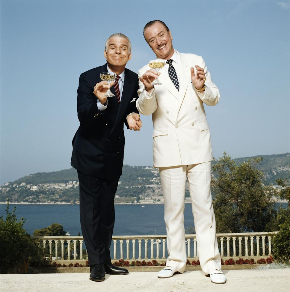 Actors Steve Martin and Michael Caine starring in Frank Oz's film Dirty Rotten Scoundrels in which the pair play competing con artists, Cote d'Azure, 1988. (Photo by Terry O'Neill/Iconic Images/Getty Images)