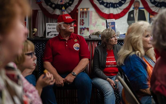Supporters of Donald Trump watch the television to see the numbers coming in at the Cochise County Republican Headquarters in Sierra Vista, Arizona - AFP