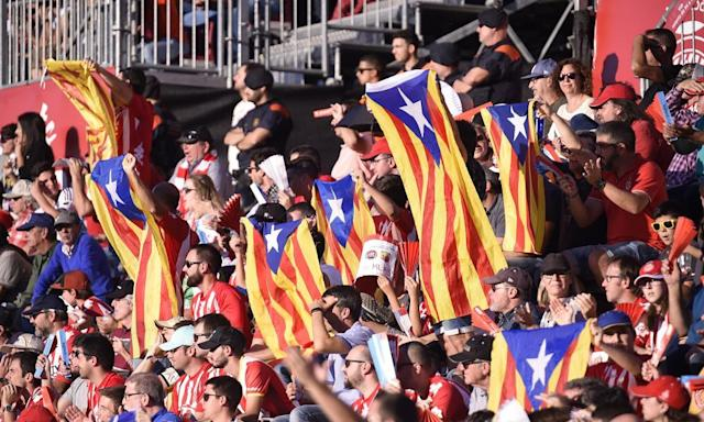 """<span class=""""element-image__caption"""">Girona fans fly at the Montilivi Stadium fly Esteladas flags to show their support for Catalan independence during the 2-1 defeat of Real Madrid.</span> <span class=""""element-image__credit"""">Photograph: Pressinphoto/Rex Shutterstock</span>"""