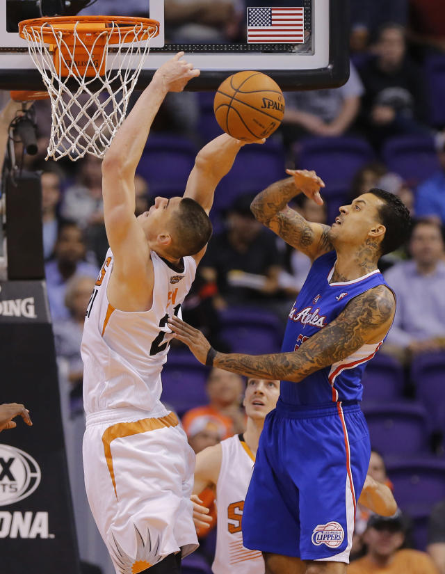 Los Angeles Clippers' Matt Barnes, right, blocks the shot of Phoenix Suns' Alex Len during the first half of an NBA basketball game, Tuesday, March 4, 2014, in Phoenix. (AP Photo/Matt York)