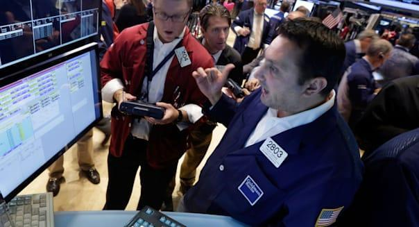 new york stock exchange traders wall street investing stocks earnings