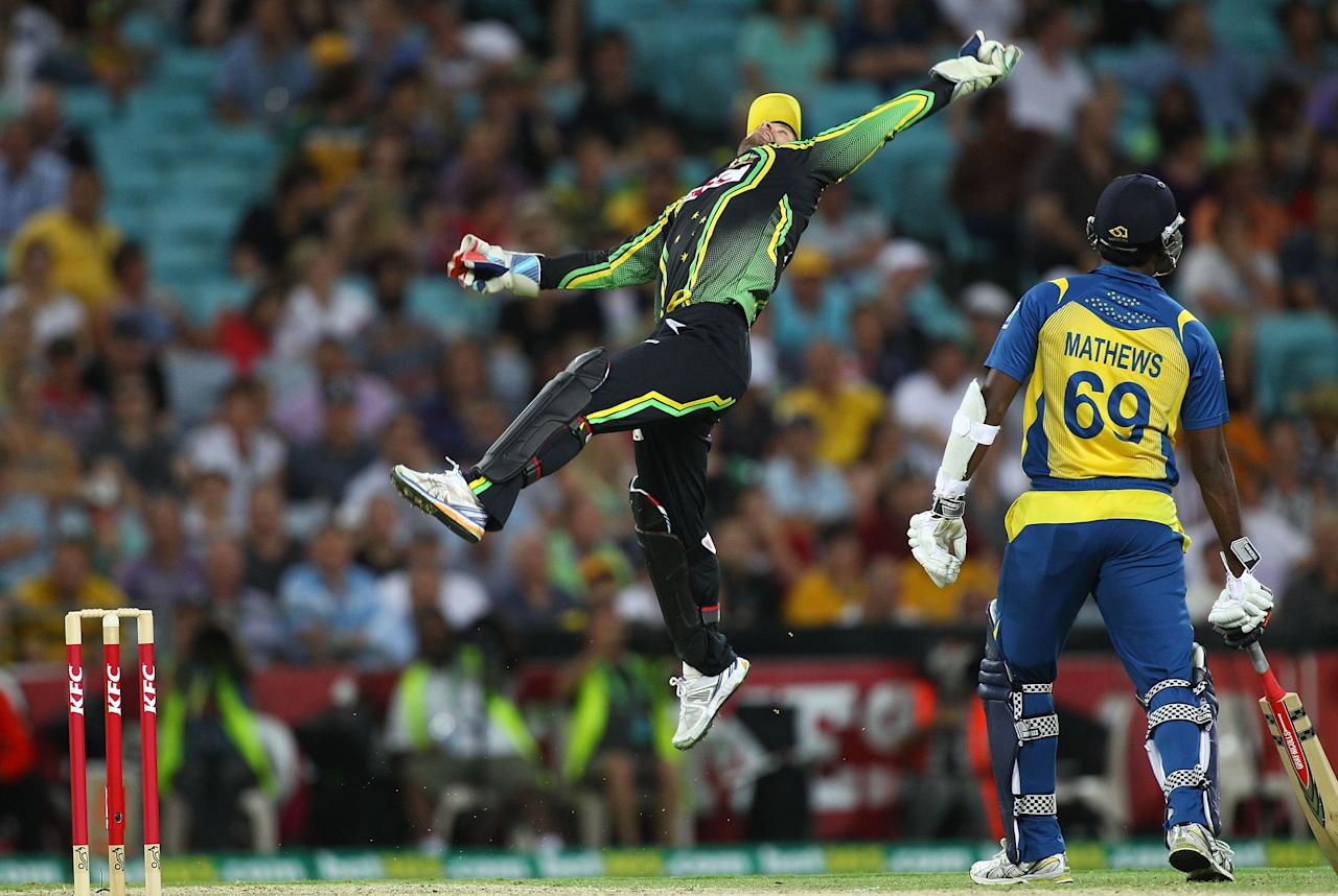 SYDNEY, AUSTRALIA - JANUARY 26:  Matthew Wade catches a return from the outfield during game one of the Twenty20 international match between Australia and Sri Lanka at ANZ Stadium on January 26, 2013 in Sydney, Australia.  (Photo by Don Arnold/Getty Images)