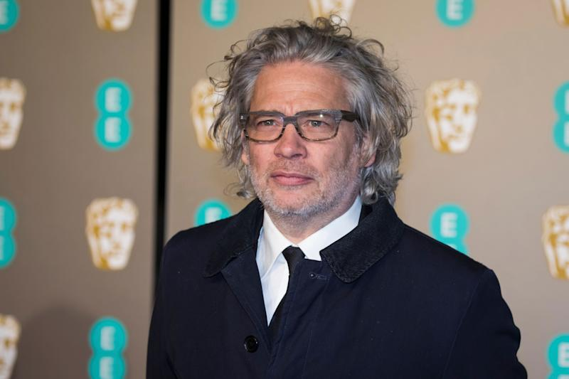Dexter Fletcher poses for photographers upon arrival at the BAFTA Film Awards in London, Sunday, Feb. 10, 2019. (Photo by Vianney Le Caer/Invision/AP)