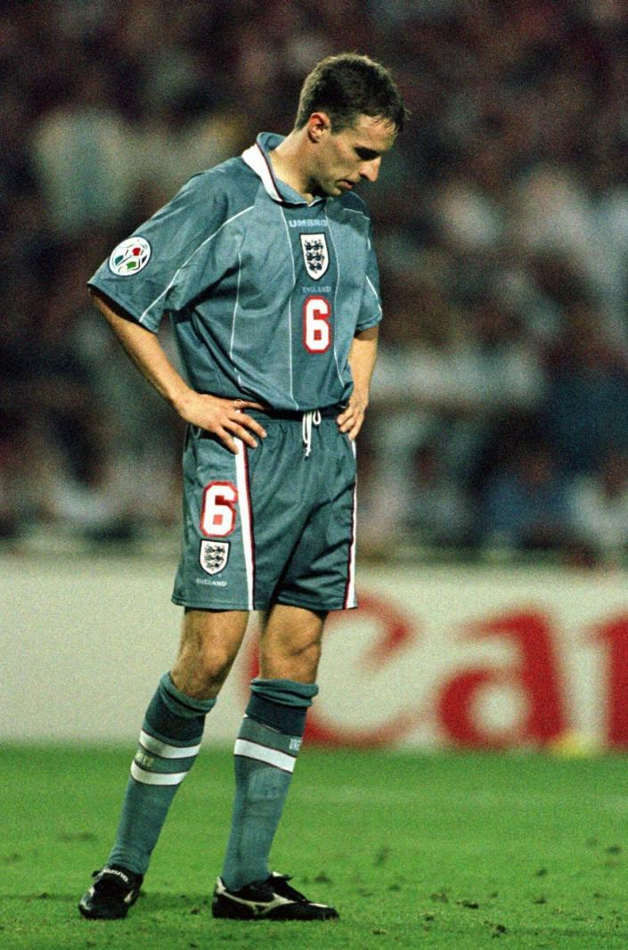 FILE - In this June 26, 1996 file photo England's Gareth Southgate bows his head after missing from the spot during a penalty shootout in the European Soccer Championships semifinal match against Germany at London's Wembley Stadium. Germany won 6-5 on penalties after the match finished 1-1 following extra time. Current England coach Gareth Southgate missed the decisive kick in the shootout, and Germany went on to win the title. (AP Photo/Lynne Sladky, File)