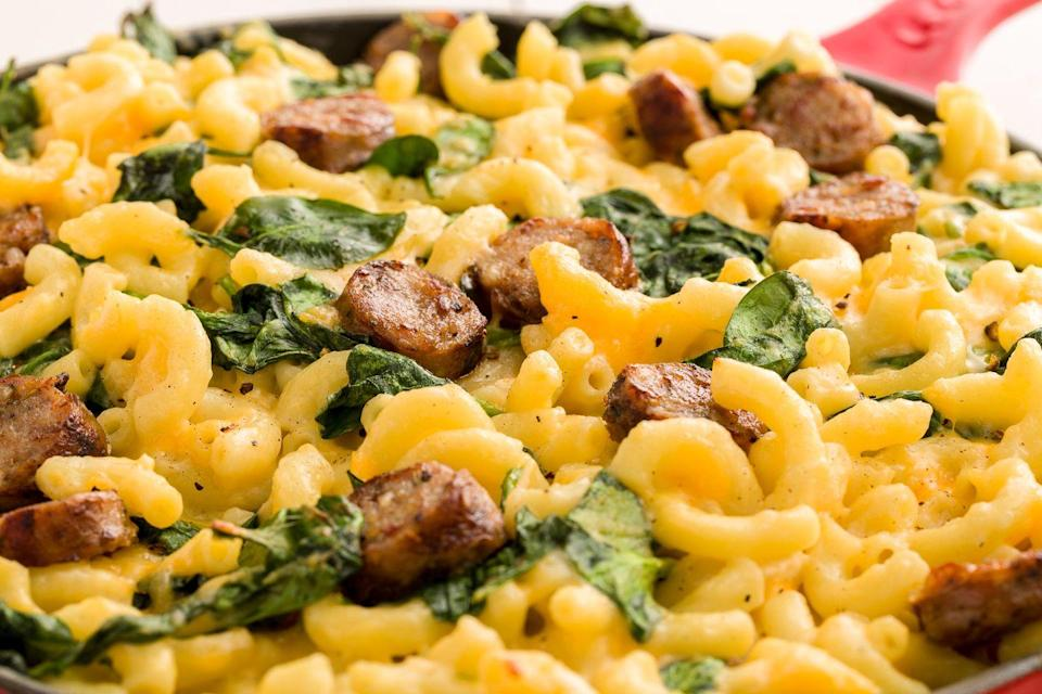 """<p>Love Trader Joe's frozen mac? Give the freezer staple a little love with sausage and greens.</p><p>Get the recipe from <a href=""""https://www.delish.com/cooking/recipe-ideas/recipes/a46154/trader-joes-mac-cheese-with-italian-sausage-and-spinach-recipe/"""" rel=""""nofollow noopener"""" target=""""_blank"""" data-ylk=""""slk:Delish"""" class=""""link rapid-noclick-resp"""">Delish</a>.</p>"""