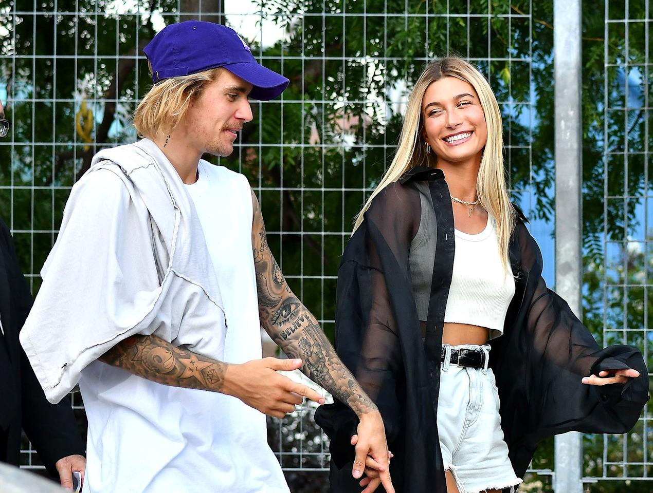 """Days before the couple <a href=""""https://people.com/music/justin-bieber-jokes-wife-hailey-baldwin-belieber/"""">would secretly marry</a>, they were spotted at New York Fashion Week in September 2018."""